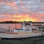American Beauty II docked during sunset at Long Wharf