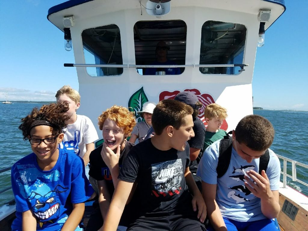 Camp group enjoying a sightseeing boat rental in the Hamptons